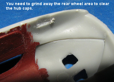 with the interior in good shape, the wheels were glued in place and left to  dry  when i went to test fit the body again, i noticed that i couldn't get  the